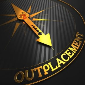 "Outplacement - Business Concept. Golden Compass Needle on a Black Field Pointing to the Word ""Outplacement"". 3D Render."