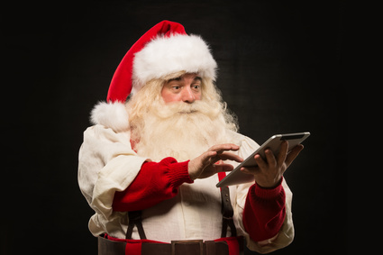 Santa Claus using tablet computer