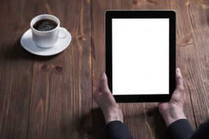 woman shows screen of digital tablet in his hands. Clipping path included.